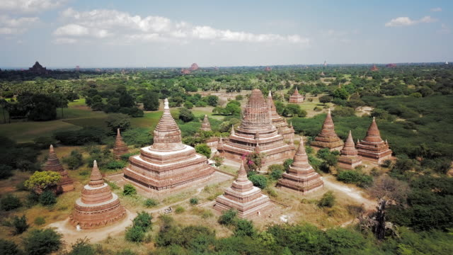 aerial: a temple on the land of old bagan - temple building stock videos & royalty-free footage