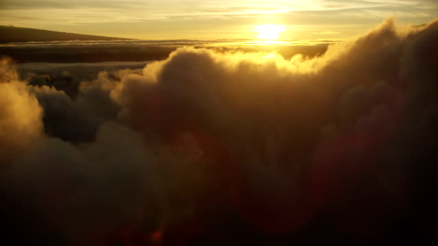 aerial above cloud setting sun view mauna kea - mauna loa stock videos and b-roll footage