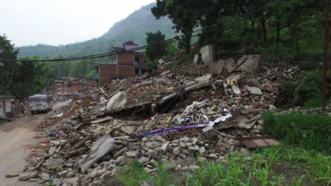aerial above street, rubble, destruction, people in street, may 2015, nepal - 2015 stock videos & royalty-free footage
