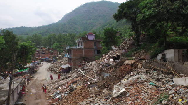 aerial above street, rubble, destruction, people in street, may 2015, nepal - 自然災害点の映像素材/bロール