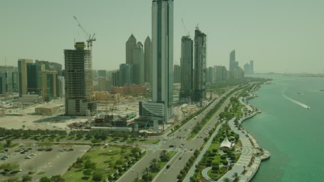 aerial abu dhabi, united arab emirates, flies along coastline - persian gulf stock videos & royalty-free footage