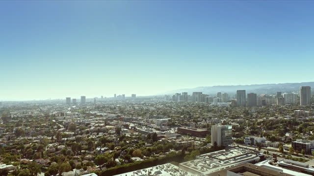 aerial across century city shopping mall and view of santa monica boulevard and high-buildings along wilshire boulevard in westwood - westwood neighborhood los angeles stock videos & royalty-free footage