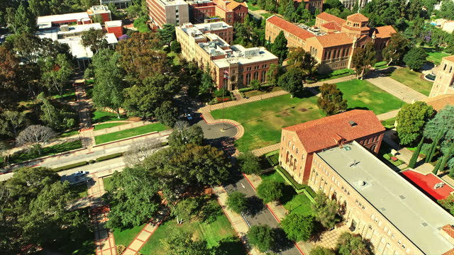 aerial across original ucla campus buildings from 1929 with royce hall, haines, fowler museum and powell library - westwood neighborhood los angeles stock videos & royalty-free footage