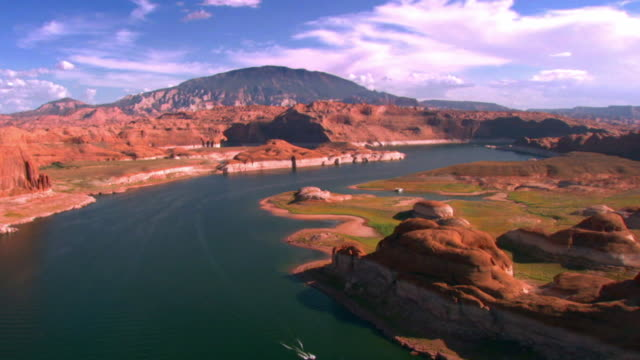 aerial across rock and sandstone formations at lake powell  / page, arizona, usa - lago powell video stock e b–roll