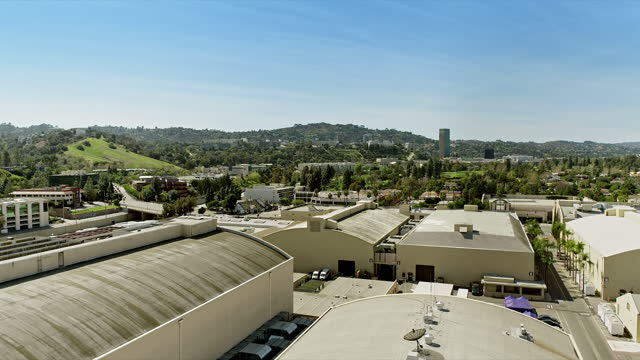 aerial across sound stages on warner brothers lot looking west towards barham boulevard and universal city in far distance - studio shot stock videos & royalty-free footage