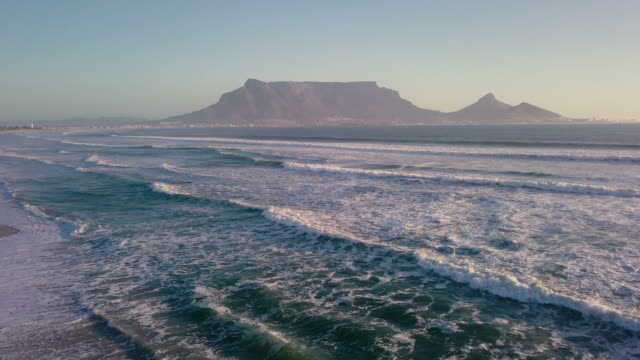 aerial across the beach to table mountain, south africa - cape town stock videos & royalty-free footage