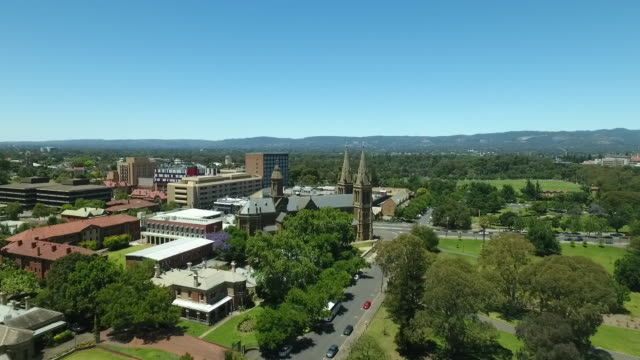 aerial adelaide with adelaide hills in the background including, st peter's anglican cathedral, botanic gardens and parklands - hill stock videos & royalty-free footage