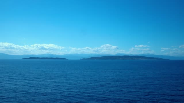 Aerial - Aegean Sea - Deep Blue - Spetses and Spetsopoula islands from a distance