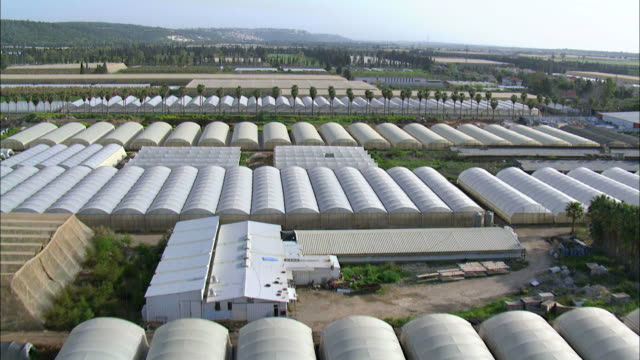 Aerial agriculture fields and greenhouses in Israel, Mediterranean coast, Israel