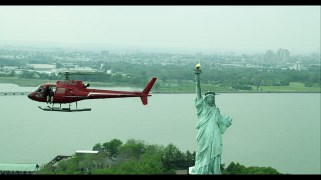 aerial air to air at the statue of liberty  - helicopter tour stock videos and b-roll footage