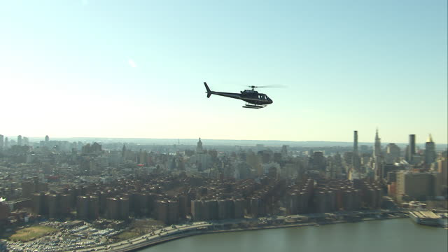 Aerial Air to Air in front of Midtown Manhattan Black Helicopter