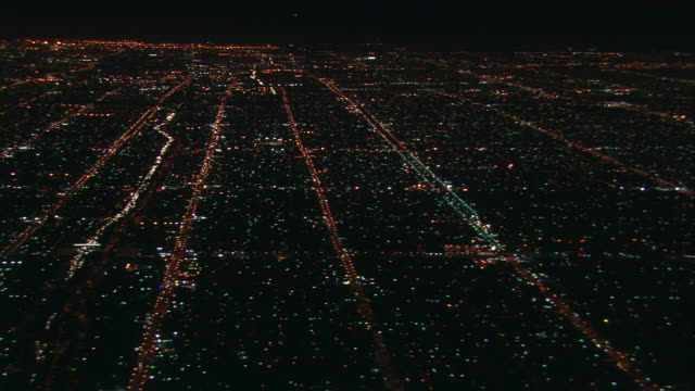 Aerial WS TS aircraft point of view at night / Downtown Los Angeles, California, United States.