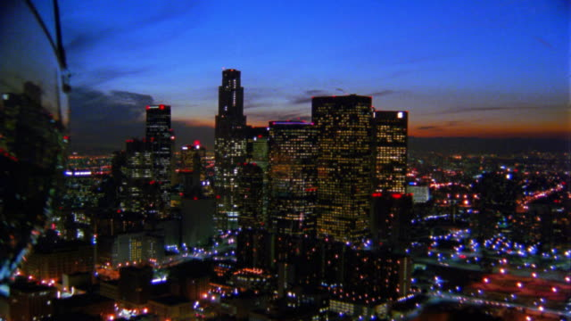 Aerial aircraft point of view over downtown Los Angeles at dusk / California