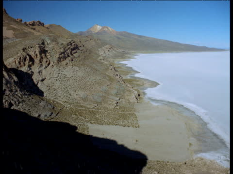 aerial along coast of uyuni islands amidst vast salt pan - bolivia stock videos & royalty-free footage