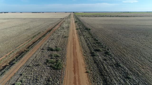 4K aerial POV along dirt road in the Outback