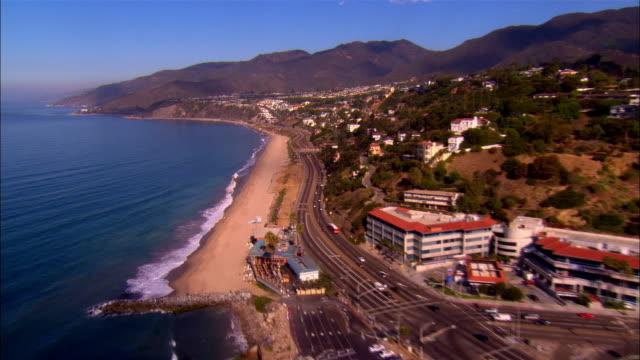 aerial along freeway and coastline/ los angeles, california - pacific ocean stock videos & royalty-free footage