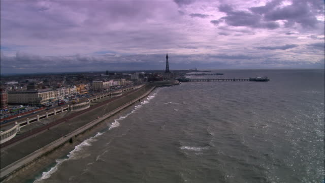aerial along golden mile/ blackpool, england - blackpool stock-videos und b-roll-filmmaterial