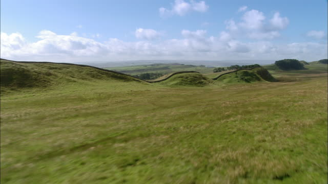 Aerial along Hadrian's Wall in English countryside / Northumberland, England