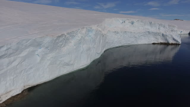 aerial along ice shelve close to bharati one of the indian stations in antarctica - antarctica drone stock videos & royalty-free footage