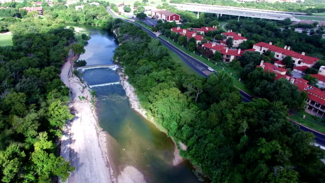 aerial: along the sunny river banks of san gabriel river over georgetown , texas - georgetown texas stock videos & royalty-free footage