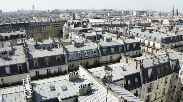 aerial: amazing houses with eiffel tower in the distance - paris, france - france stock videos & royalty-free footage