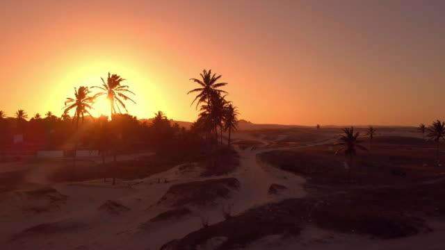 aerial: amazing sunset over sand dunes, sand dune lagoon, brazil - sanddüne stock-videos und b-roll-filmmaterial