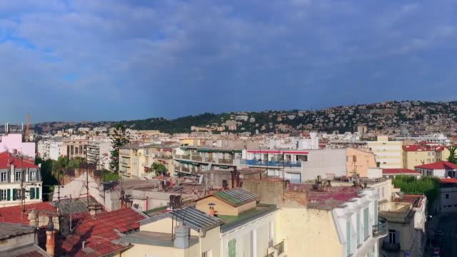 aerial: an aerial of mediterranean style buildings in nice - ヤシ点の映像素材/bロール