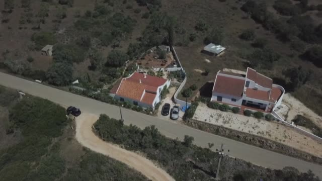 aerial and ground images show the portugal house where the suspect in the madeleine mccann case lived at the time of her disappearance - algarve stock videos & royalty-free footage