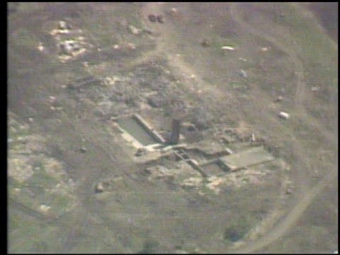 aerial and ground views of destroyed branch davidian cult compound after fbi siege aerial ground view of destroyed waco compound on april 21 1993 in... - cult stock videos & royalty-free footage