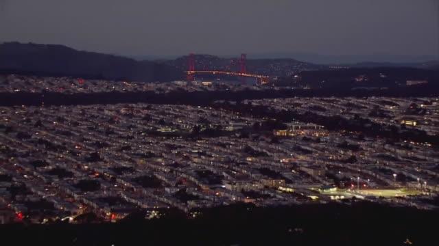aerial and pull back to san francisco at dusk. - san francisco california stock videos & royalty-free footage