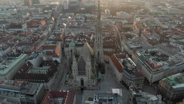aerial: angling around st. stephen's cathedral in city of vienna, austria - wien stock-videos und b-roll-filmmaterial