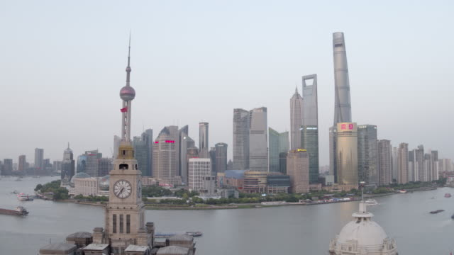 ws aerial approach of shanghai lujiazui skyline with custom house, huangpu river, pearl tower, jin mao, world financial center, the bund - custom house tower stock videos & royalty-free footage