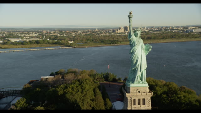 Aerial Approach Statue of Liberty Reveal Downtown