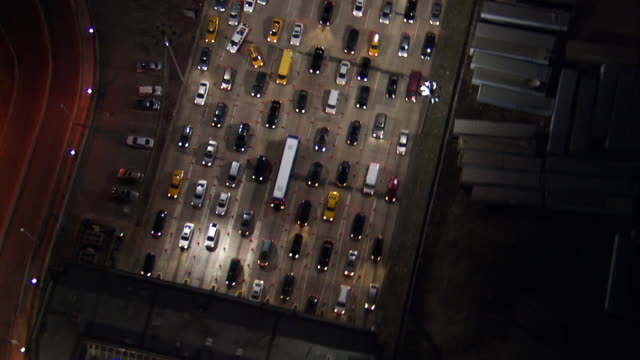 aerial approach tilt down and orbit the entrance to the holland tunnel - traffic jam stock videos & royalty-free footage
