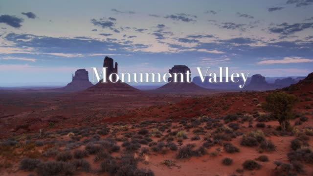 "aerial approach to iconic buttes through floating text: ""monument valley"" - navajo reservation stock videos and b-roll footage"