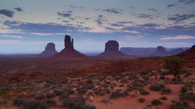 aerial approach to monument valley buttes - navajo culture stock videos & royalty-free footage