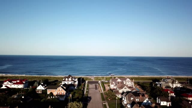 aerial approach to the atlantic ocean over beach front homes in spring lake new jersey - ocean avenue stock videos & royalty-free footage