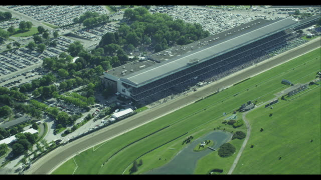 aerial approach zoom in belmont racetrack crowd - pferderennbahn stock-videos und b-roll-filmmaterial