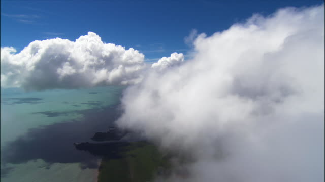 aerial approaching key largo through clouds/ florida keys - the florida keys stock videos & royalty-free footage