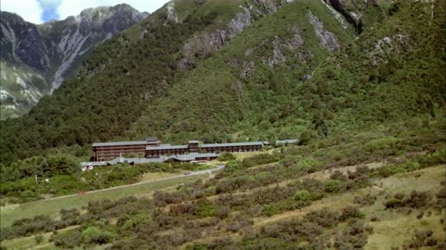 Aerial approaching mountain resort / New Zealand