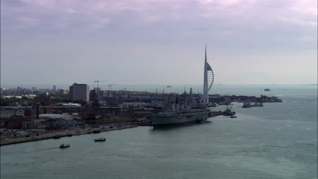 aerial approaching naval base with hms victoy and aircraft carrier/ portsmouth, england - navy stock videos and b-roll footage
