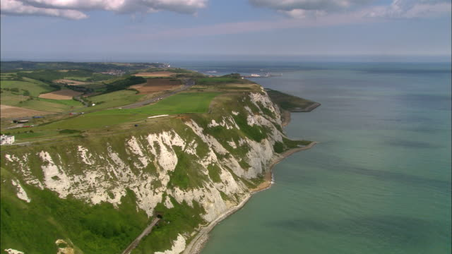 aerial approaching the white cliffs of dover / kent, england - english channel stock videos & royalty-free footage