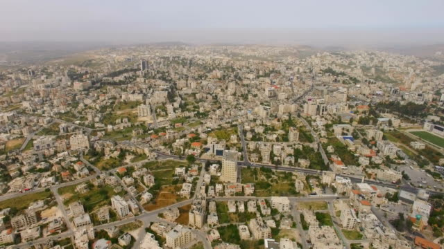 aerial / arab city of ramallah, palestinian territories - palestinian territories stock videos and b-roll footage