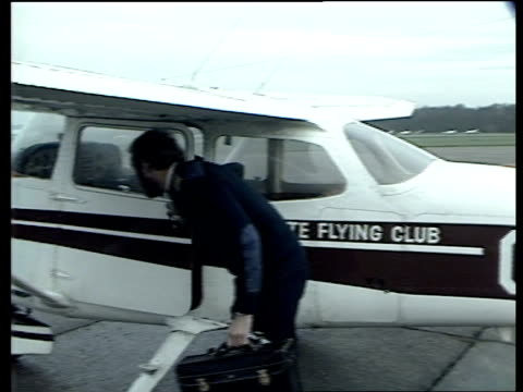 aerial archaeology; aerial archaeology; england: kent: biggin hill: cms photographic expert & pilot chat beside light aircraft then pilot gets in... - biggin hill stock videos & royalty-free footage