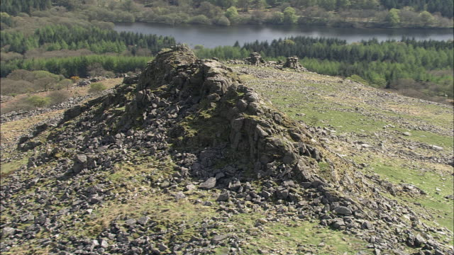 aerial around exposed granite tor, dartmoor, uk - granite rock stock videos and b-roll footage
