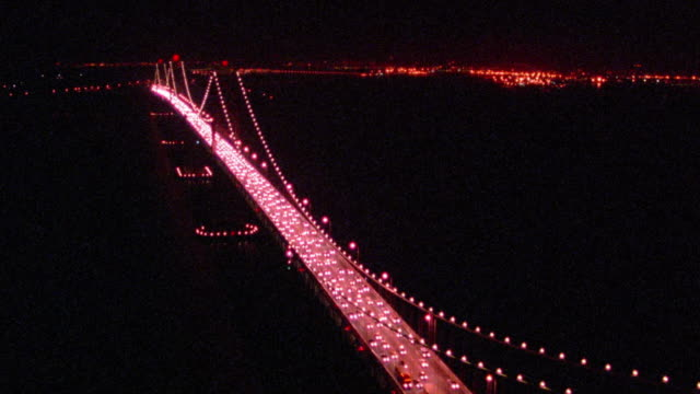 aerial around lit bay bridge with traffic at night / overhead traffic / san francisco, california - 50 seconds or greater stock videos & royalty-free footage