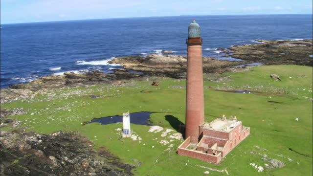 Aerial around Monach Islands lighthouse, Scotland, UK