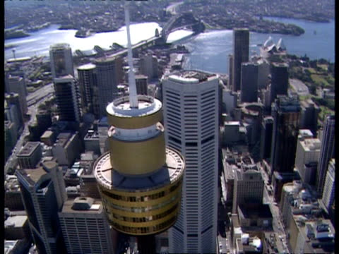 wa aerial around sydney's centrepoint tower, looking across city and harbour - bennelong point stock videos and b-roll footage