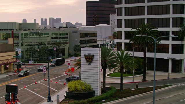 aerial ascending shot of the beverly hills sign on san vicente boulevard - century city stock videos & royalty-free footage
