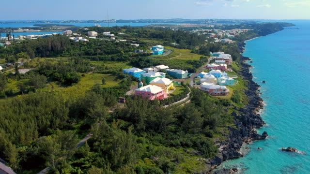 aerial ascending slow: luxurious homes in the village of bermuda near coast in spanish point, bermuda - bermuda stock videos & royalty-free footage